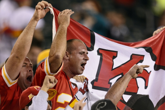 Sep 19, 2013; Philadelphia, PA, USA; Kansas City Chiefs fans celebrate late in the fourth quarter against the Philadelphia Eagles at Lincoln Financial Field. The Chiefs defeated the Eagles 26-16. Mandatory Credit: Howard Smith-USA TODAY Sports
