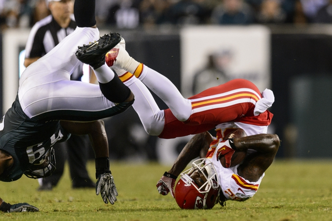Sep 19, 2013; Philadelphia, PA, USA; Kansas City Chiefs wide receiver Dwayne Bowe (82) rolls over as he is tackled during the fourth quarter against the Philadelphia Eagles at Lincoln Financial Field. The Chiefs defeated the Eagles 26-16. Mandatory Credit: Howard Smith-USA TODAY Sports