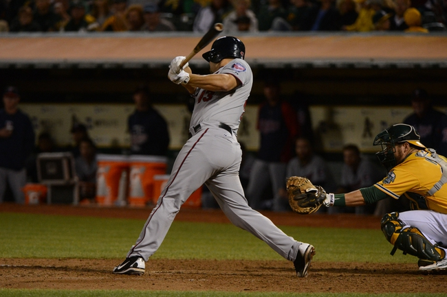 September 19, 2013; Oakland, CA, USA; Minnesota Twins catcher Josmil Pinto (43) hits a RBI-single to score right fielder Oswaldo Arcia (31, not pictured) against the Oakland Athletics during the sixth inning at O.co Coliseum. Mandatory Credit: Kyle Terada-USA TODAY Sports