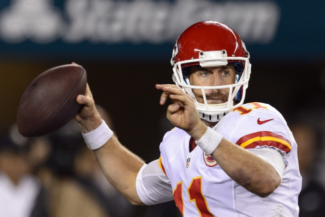 Sep 19, 2013; Philadelphia, PA, USA; Kansas City Chiefs quarterback Alex Smith (11) passes the ball during the fourth quarter against the Philadelphia Eagles at Lincoln Financial Field. The Chiefs defeated the Eagles 26-16. Mandatory Credit: Howard Smith-USA TODAY Sports