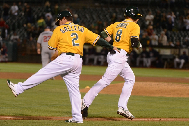 September 19, 2013; Oakland, CA, USA; Oakland Athletics shortstop Jed Lowrie (8, right) is congratulated by third base coach Mike Gallego (2) for hitting a three-run home run against the Minnesota Twins during the sixth inning at O.co Coliseum. Mandatory Credit: Kyle Terada-USA TODAY Sports