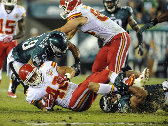 Sep 19, 2013; Philadelphia, PA, USA; Philadelphia Eagles inside linebacker Mychal Kendricks (95) tackles Kansas City Chiefs fullback Anthony Sherman (42) during the fourth quarter of the game at Lincoln Financial Field. The Kansas City Chiefs beat the Philadelphia Eagles 26-16. Mandatory Credit: John Geliebter-USA TODAY Sports