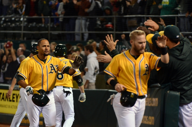 September 19, 2013; Oakland, CA, USA; Oakland Athletics center fielder Coco Crisp (4, left) and first baseman Daric Barton (10, right) are congratulated for scoring on Crisp's two-run home run against the Minnesota Twins during the eighth inning at O.co Coliseum. The Athletics defeated the Twins 8-6. Mandatory Credit: Kyle Terada-USA TODAY Sports