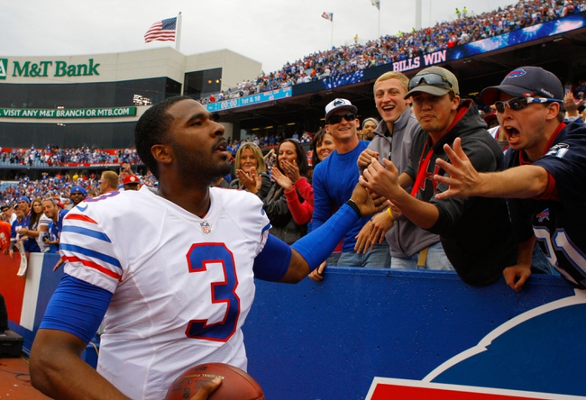Sep 15, 2013; Orchard Park, NY, USA; Fans congratulate Buffalo Bills quarterback EJ Manuel (3) after a win against the Carolina Panthers at Ralph Wilson Stadium. Buffalo beats Carolina 27 to 26.  Mandatory Credit: Timothy T. Ludwig-USA TODAY Sports