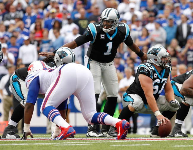 Sep 15, 2013; Orchard Park, NY, USA; Carolina Panthers quarterback Cam Newton (1) signals a play during the game against the Buffalo Bills at Ralph Wilson Stadium. Mandatory Credit: Kevin Hoffman-USA TODAY Sports