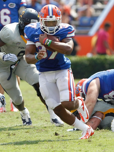 Aug 31, 2013; Gainesville, FL, USA; Florida Gators running back Mark Herndon (37) runs with the ball against the Toledo Rockets during the second half at Ben Hill Griffin Stadium. Florida Gators defeated the Toledo Rockets 24-6. Mandatory Credit: Kim Klement-USA TODAY Sports