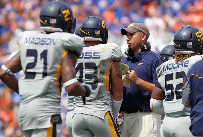 Aug 31, 2013; Gainesville, FL, USA; Toledo Rockets head coach Matt Campbell talks with the team against the Florida Gators during the second half at Ben Hill Griffin Stadium. Florida Gators defeated the Toledo Rockets 24-6. Mandatory Credit: Kim Klement-USA TODAY Sports