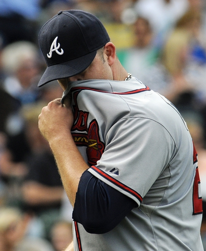 Sep 20, 2013; Chicago, IL, USA; Atlanta Braves pitcher Paul Maholm wipes his face after being relieved in the seventh inning of their game against the Chicago Cubs at Wrigley Field. Mandatory Credit: Matt Marton-USA TODAY Sports