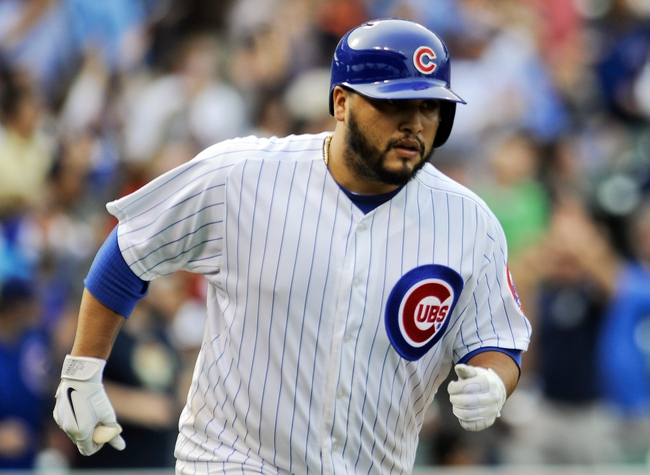Sep 20, 2013; Chicago, IL, USA; Chicago Cubs catcher Dioner Navarro runs the bases after he hits a home run in the 8th inning of their game against the Atlanta Braves at Wrigley Field. Mandatory Credit: Matt Marton-USA TODAY Sports