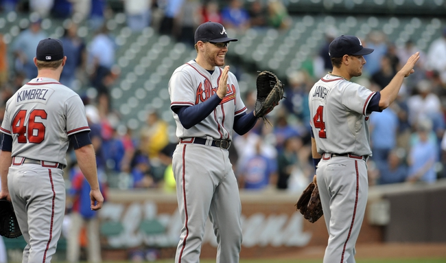 Sep 20, 2013; Chicago, IL, USA; Atlanta Braves pitcher Craig Kimbrel (left) and infielder Freddie Freeman (middle) react after their game against the Chicago Cubs at Wrigley Field. Mandatory Credit: Matt Marton-USA TODAY Sports