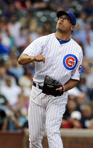 Sep 20, 2013; Chicago, IL, USA; Chicago Cubs pitcher Kevin Gregg in the 9th inning of their game against the Atlanta Braves at Wrigley Field. Mandatory Credit: Matt Marton-USA TODAY Sports