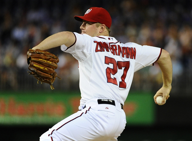 Sep 20, 2013; Washington, DC, USA; Washington Nationals pitcher Jordan Zimmermann (27) throws during the first inning against the Miami Marlins at Nationals Park. Mandatory Credit: Brad Mills-USA TODAY Sports