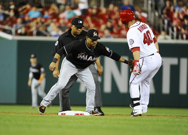 Sep 20, 2013; Washington, DC, USA; Washington Nationals catcher Wilson Ramos (40) is tagged out by Miami Marlins second baseman Donovan Solano (17) attempting to stretch a single to a double during the second inning at Nationals Park. Mandatory Credit: Brad Mills-USA TODAY Sports