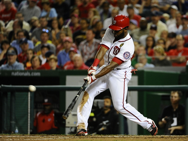 Sep 20, 2013; Washington, DC, USA; Washington Nationals center fielder Denard Span (2) hits a two run RBI triple against the Miami Marlins during the sixth inning at Nationals Park. Mandatory Credit: Brad Mills-USA TODAY Sports