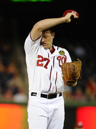 Sep 20, 2013; Washington, DC, USA; Washington Nationals starting pitcher Jordan Zimmermann (27) wipes his brow during the ninth inning against the Miami Marlins at Nationals Park. Mandatory Credit: Brad Mills-USA TODAY Sports