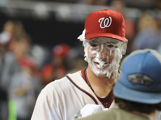 Sep 20, 2013; Washington, DC, USA; Washington Nationals pitcher Jordan Zimmermann (27) reacts after a shaving cream pie to the face after the game against the Miami Marlins at Nationals Park. Mandatory Credit: Brad Mills-USA TODAY Sports