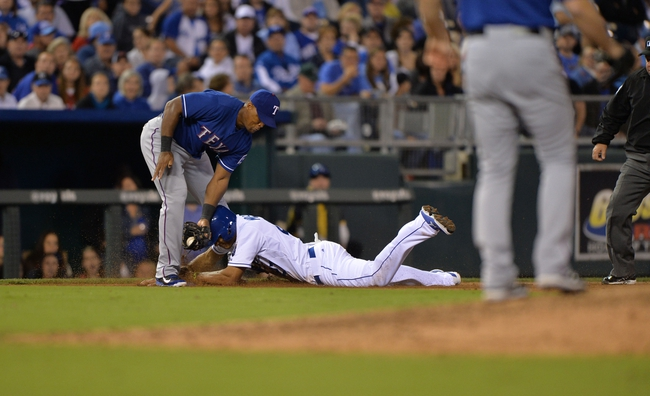 Sep 20, 2013; Kansas City, MO, USA; Texas Rangers third basemen Adrian Beltre (29) tags out Kansas City Royals base runner Justin Maxwell (27) attempting to steal third to end the bottom of the sixth inning at Kauffman Stadium. Mandatory Credit: Peter G. Aiken-USA TODAY Sports