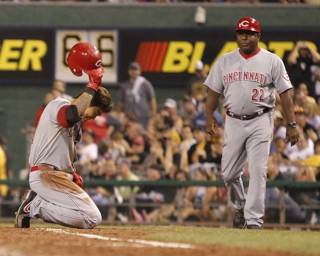 Sep 20, 2013; Pittsburgh, PA, USA; Cincinnati Reds center fielder Shin-Soo Choo (left) reacts after making the final out of the ninth inning against the Pittsburgh Pirates at PNC Park. The Cincinnati Reds won 6-5 in ten innings.  Mandatory Credit: Charles LeClaire-USA TODAY Sports