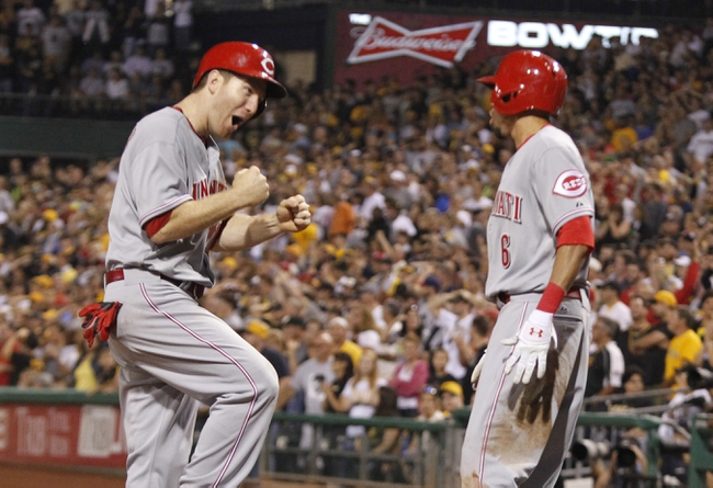Sep 20, 2013; Pittsburgh, PA, USA; Cincinnati Reds third baseman Todd Frazier (left) and pinch runner Billy Hamilton (6) celebrate after both players scored to tie the score against the Pittsburgh Pirates during the ninth inning at PNC Park. The Cincinnati Reds won 6-5 in ten innings. Mandatory Credit: Charles LeClaire-USA TODAY Sports