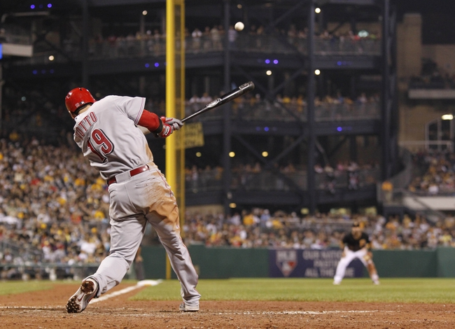 Sep 20, 2013; Pittsburgh, PA, USA; Cincinnati Reds first baseman Joey Votto (19) hits a game winning solo home run against the Pittsburgh Pirates during the tenth inning at PNC Park. The Cincinnati Reds won 6-5 in ten innings. Mandatory Credit: Charles LeClaire-USA TODAY Sports