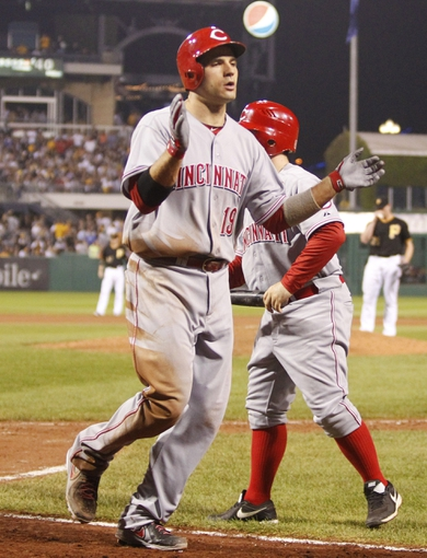 Sep 20, 2013; Pittsburgh, PA, USA; Cincinnati Reds first baseman Joey Votto (19) reacts after hitting a solo home run  during the tenth inning against the Pittsburgh Pirates at PNC Park. The Cincinnati Reds won 6-5 in ten innings.  Mandatory Credit: Charles LeClaire-USA TODAY Sports