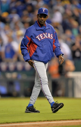 Sep 20, 2013; Kansas City, MO, USA; Texas Rangers manager Ron Washington (38) walks back to the dugout after making a pitching change against the Kansas City Royals during the eighth inning at Kauffman Stadium. The Royals defeated the Rangers 2-1. Mandatory Credit: Peter G. Aiken-USA TODAY Sports