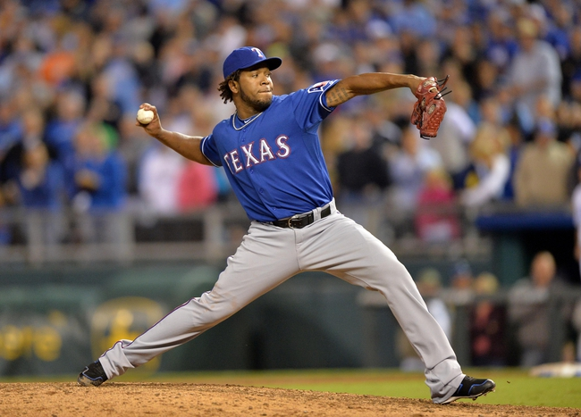 Sep 20, 2013; Kansas City, MO, USA; Texas Rangers pitcher Nefali Perez (30) delivers a pitch against the Kansas City Royals during the eighth inning at Kauffman Stadium. The Royals defeated the Rangers 2-1. Mandatory Credit: Peter G. Aiken-USA TODAY Sports