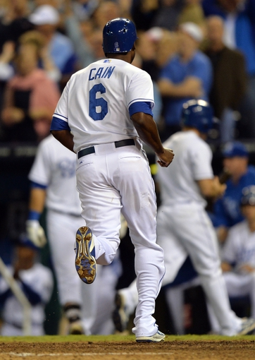 Sep 20, 2013; Kansas City, MO, USA; Kansas City Royals base runner Lorenzo Cain (6) scores the go ahead run after a bases loaded walk against the Texas Rangers during the eighth inning at Kauffman Stadium. The Royals defeated the Rangers 2-1. Mandatory Credit: Peter G. Aiken-USA TODAY Sports