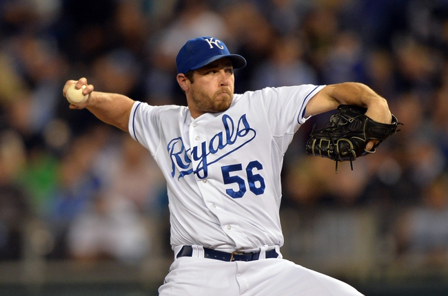 Sep 20, 2013; Kansas City, MO, USA; Kansas City Royals pitcher Greg Holland (56) delivers a pitch against the Texas Rangers during the ninth inning at Kauffman Stadium. The Royals defeated the Rangers 2-1. Mandatory Credit: Peter G. Aiken-USA TODAY Sports