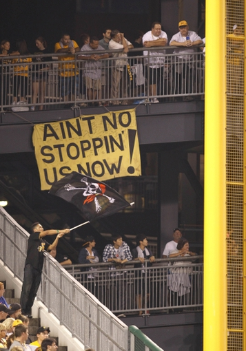 Sep 20, 2013; Pittsburgh, PA, USA; Pittsburgh Pirates fans watch the action from the left field rotunda against the Cincinnati Reds during the ninth inning at PNC Park. The Cincinnati Reds won 6-5 in ten innings. Mandatory Credit: Charles LeClaire-USA TODAY Sports