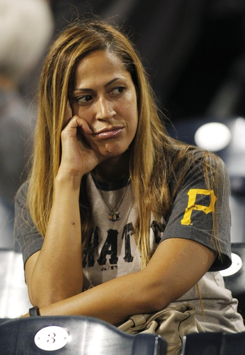 Sep 20, 2013; Pittsburgh, PA, USA; Pittsburgh Pirates fan Nina Reyes of Ashburn Virginia reacts after the Cincinnati Reds defeated the Pittsburgh Pirates in extra innings at PNC Park. The Cincinnati Reds won 6-5 in ten innings. Mandatory Credit: Charles LeClaire-USA TODAY Sports