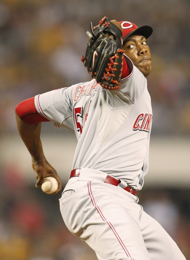 Sep 20, 2013; Pittsburgh, PA, USA; Cincinnati Reds relief pitcher Aroldis Chapman (54) pitches against the Pittsburgh Pirates during the tenth inning at PNC Park. The Cincinnati Reds won 6-5 in ten innings. Mandatory Credit: Charles LeClaire-USA TODAY Sports