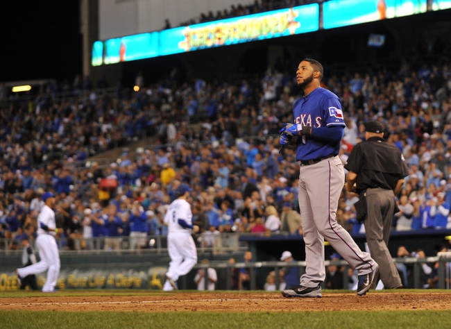 Sep 20, 2013; Kansas City, MO, USA; Texas Rangers shortstop Elvis andrus (1) reacts after striking out with the bases loaded to end the top of the fifth inning against the Kansas City Royals at Kauffman Stadium. The Royals defeated the Rangers 2-1. Mandatory Credit: Peter G. Aiken-USA TODAY Sports