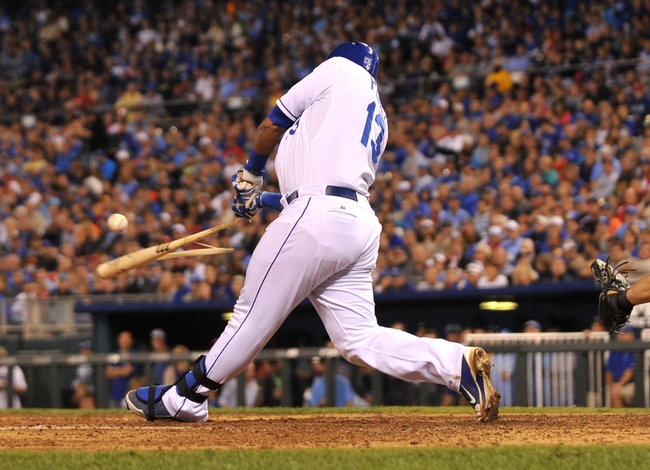 Sep 20, 2013; Kansas City, MO, USA; Kansas City Royals catcher Salvador Perez (13) shatters his bat as he lines out to end the fifth inning against the Texas Rangers at Kauffman Stadium. The Royals defeated the Rangers 2-1. Mandatory Credit: Peter G. Aiken-USA TODAY Sports