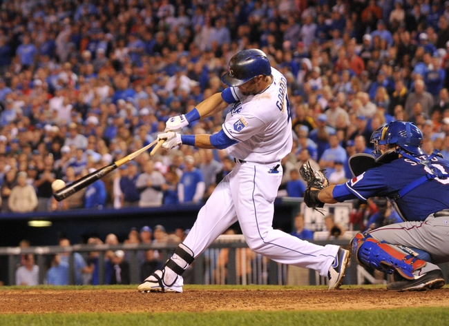 Sep 20, 2013; Kansas City, MO, USA; Kansas City Royals left fielder Alex Gordon (4) shatters his bat on a pitch against the Texas Rangers during the eighth inning at Kauffman Stadium. The Royals defeated the Rangers 2-1. Mandatory Credit: Peter G. Aiken-USA TODAY Sports