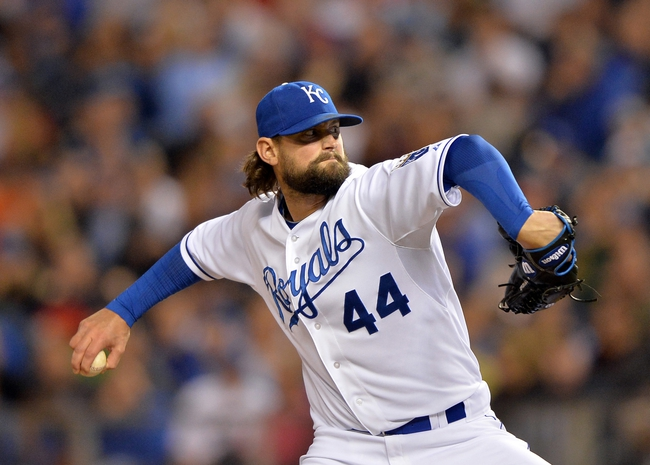 Sep 20, 2013; Kansas City, MO, USA; Kansas City Royals pitcher Luke Hochevar (44) delivers a pitch against the Texas Rangers during the eighth inning at Kauffman Stadium. The Royals defeated the Rangers 2-1. Mandatory Credit: Peter G. Aiken-USA TODAY Sports