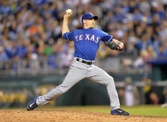 Sep 20, 2013; Kansas City, MO, USA; Texas Rangers pitcher Jason Frasor (44) delivers a pitch against the Kansas City Royals during the eighth inning at Kauffman Stadium. The Royals defeated the Rangers 2-1. Mandatory Credit: Peter G. Aiken-USA TODAY Sports