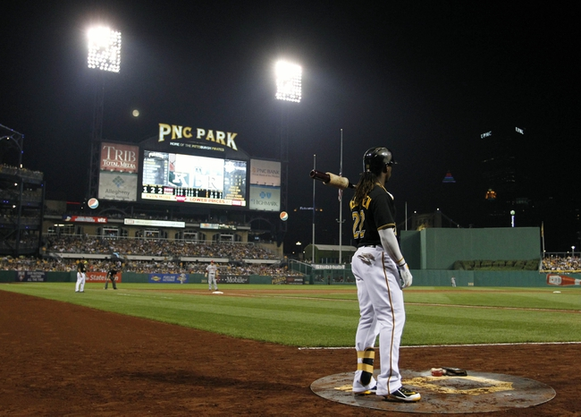 Sep 20, 2013; Pittsburgh, PA, USA; Pittsburgh Pirates center fielder Andrew McCutchen (22) waits to bat in the on-deck circle against the Cincinnati Reds during the seventh inning at PNC Park. The Cincinnati Reds won 6-5 in ten innings. Mandatory Credit: Charles LeClaire-USA TODAY Sports