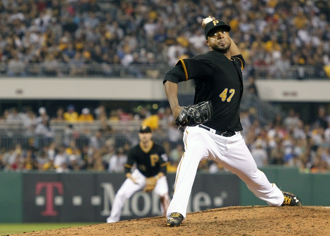 Sep 20, 2013; Pittsburgh, PA, USA; Pittsburgh Pirates starting pitcher Francisco Liriano (47) delivers a pitch the Cincinnati Reds during the eighth inning at PNC Park. The Cincinnati Reds won 6-5 in ten innings. Mandatory Credit: Charles LeClaire-USA TODAY Sports