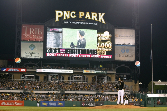 Sep 20, 2013; Pittsburgh, PA, USA; Pittsburgh Pirates starting pitcher Francisco Liriano (47) reacts to a scoreboard tribute recognizing the 1000th strikeout of his career against the Cincinnati Reds during the eighth inning at PNC Park. The Cincinnati Reds won 6-5 in ten innings. Mandatory Credit: Charles LeClaire-USA TODAY Sports