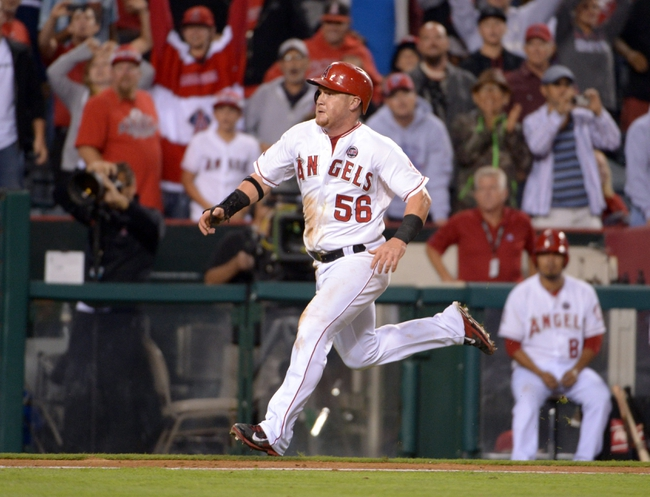 Sep 20, 2013; Anaheim, CA, USA; Los Angeles Angels right fielder Kole Calhoun (56) scores the winning run in the 11th inning against the Seattle Mariners at Angel Stadium. The Angels defeated the Mariners 3-2 in 11 innings. Mandatory Credit: Kirby Lee-USA TODAY Sports
