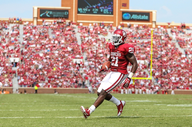 Sep 14, 2013; Norman, OK, USA; Oklahoma Sooners running back Keith Ford (21) scores a touchdown during the game against the Tulsa Golden Hurricane at Gaylord Family - Oklahoma Memorial Stadium. Oklahoma won 51-20. Mandatory Credit: Kevin Jairaj-USA TODAY Sports