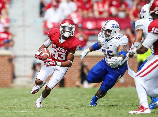 Sep 14, 2013; Norman, OK, USA; Oklahoma Sooners wide receiver Austin Bennett (83) runs past Tulsa Golden Hurricane linebacker Shawn Jackson (55) during the game at Gaylord Family - Oklahoma Memorial Stadium. Oklahoma won 51-20. Mandatory Credit: Kevin Jairaj-USA TODAY Sports