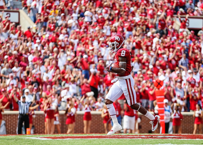 Sep 14, 2013; Norman, OK, USA; Oklahoma Sooners wide receiver Jalen Saunders (8) scores a touchdown during the game against the Tulsa Golden Hurricane at Gaylord Family - Oklahoma Memorial Stadium. Oklahoma won 51-20. Mandatory Credit: Kevin Jairaj-USA TODAY Sports