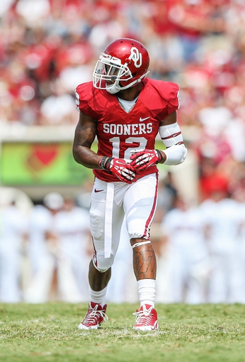 Sep 14, 2013; Norman, OK, USA; Oklahoma Sooners wide receiver Derrick Woods (12) lines up during the game against the Tulsa Golden Hurricane at Gaylord Family - Oklahoma Memorial Stadium. Oklahoma won 51-20. Mandatory Credit: Kevin Jairaj-USA TODAY Sports