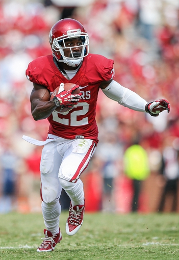 Sep 14, 2013; Norman, OK, USA; Oklahoma Sooners running back Roy Finch (22) runs with the ball during the game against the Tulsa Golden Hurricane at Gaylord Family - Oklahoma Memorial Stadium. Oklahoma won 51-20. Mandatory Credit: Kevin Jairaj-USA TODAY Sports