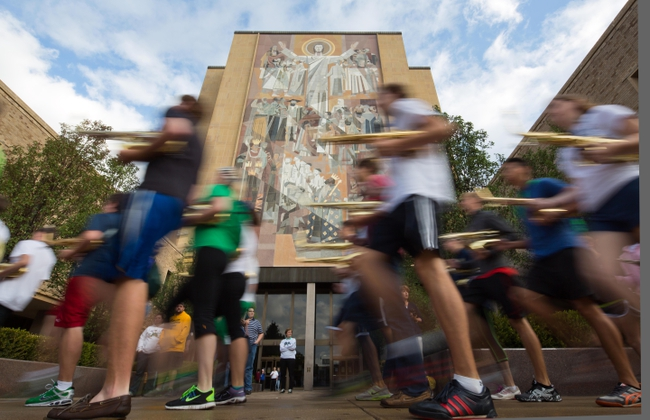 Sep 21, 2013; South Bend, IN, USA; The Notre Dame marching band walks past the Word of Life mural on Hesburgh Library , known as Touchdown Jesus , on the Notre Dame campus before the game between the Notre Dame Fighting Irish and the Michigan State Spartans at Notre Dame Stadium. Mandatory Credit: Matt Cashore-USA TODAY Sports