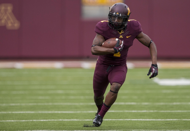 Sep 21, 2013; Minneapolis, MN, USA; Minnesota Golden Gophers wide receiver KJ Maye (1) rushes with the ball for a first down in the first quarter against the San Jose State Spartans at TCF Bank Stadium. Mandatory Credit: Jesse Johnson-USA TODAY Sports