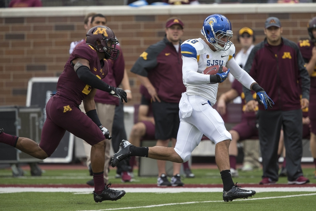 Sep 21, 2013; Minneapolis, MN, USA; San Jose State Spartans tight end Billy Freeman (18) runs with the ball after making a catch in the first quarter as Minnesota Golden Gophers defensive back Cedric Thompson (2) attempts to make a tackle at TCF Bank Stadium. Mandatory Credit: Jesse Johnson-USA TODAY Sports
