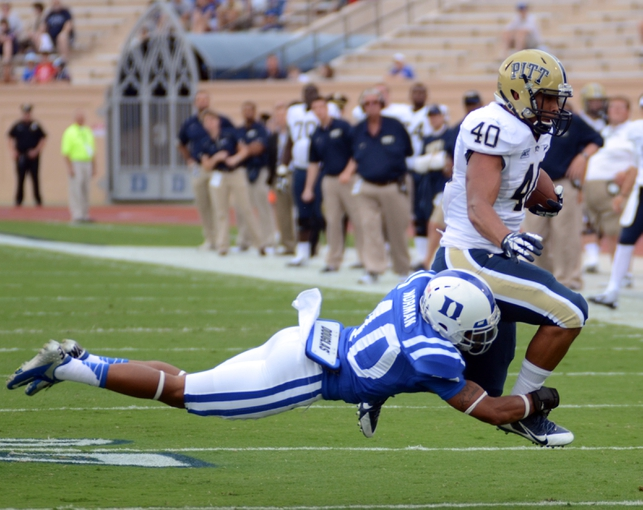 Sep 21, 2013; Durham, NC, USA;  Pitt Panthers running back James Conner (40) runs the ball as Duke Blue Devils  safety Dwayne Norman (40) attempts to make the tackle during the first half at Wallace Wade Stadium. Mandatory Credit: Rob Kinnan-USA TODAY Sports